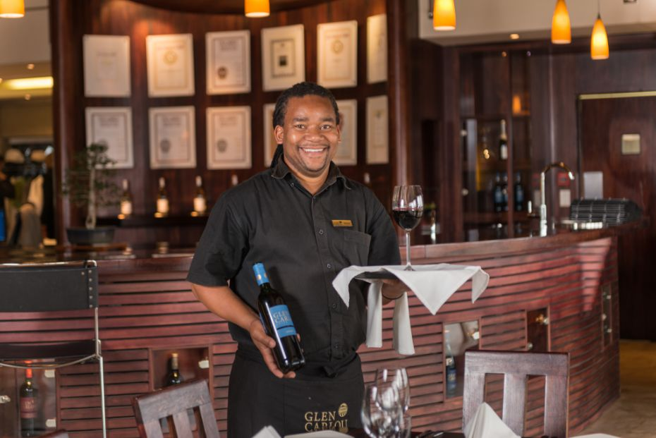 Waiter-pouring-wine-at-a-table.jpg
