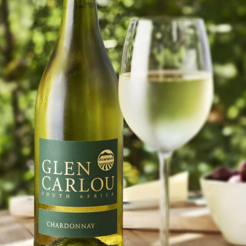 Glen Carlou Chardonnay with glass on table