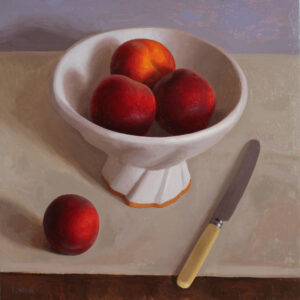 peaches in a white bowl