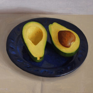avocados on blue plate