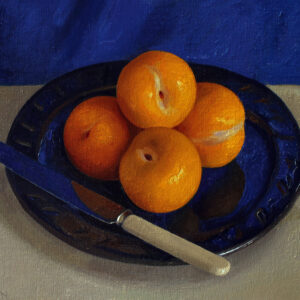 yellow plums on blue plate